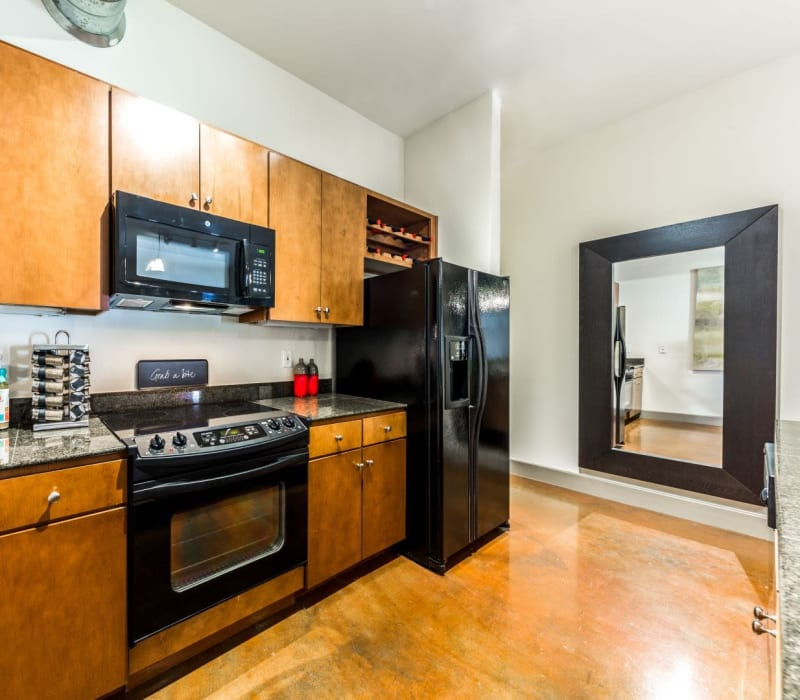 Kitchen with black appliances at Marquis Lofts on Sabine in Houston, Texas