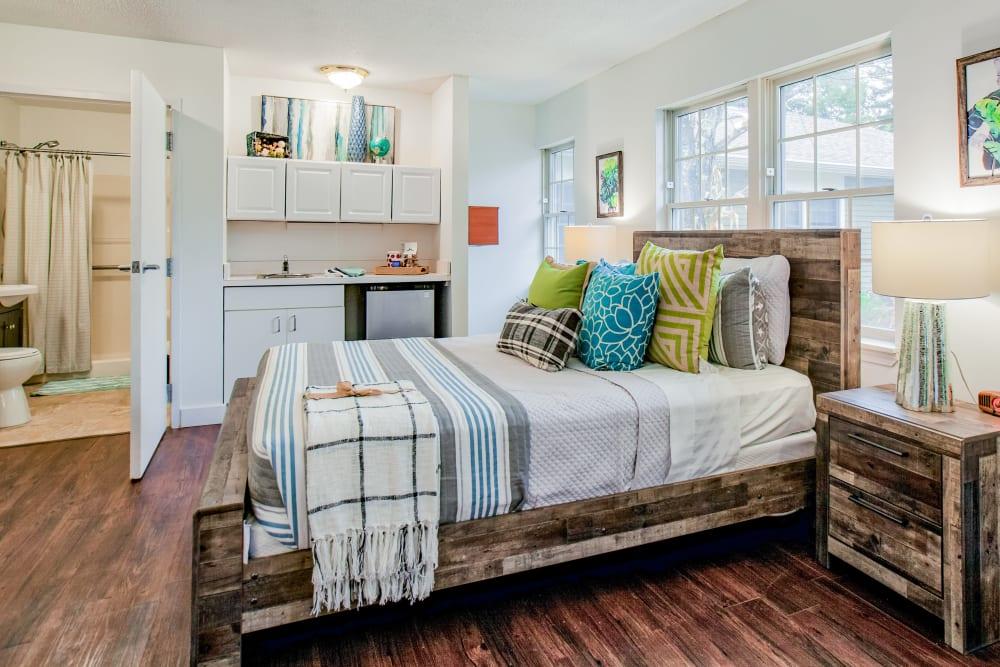Model bedroom with bathroom at Wood Haven Senior Living