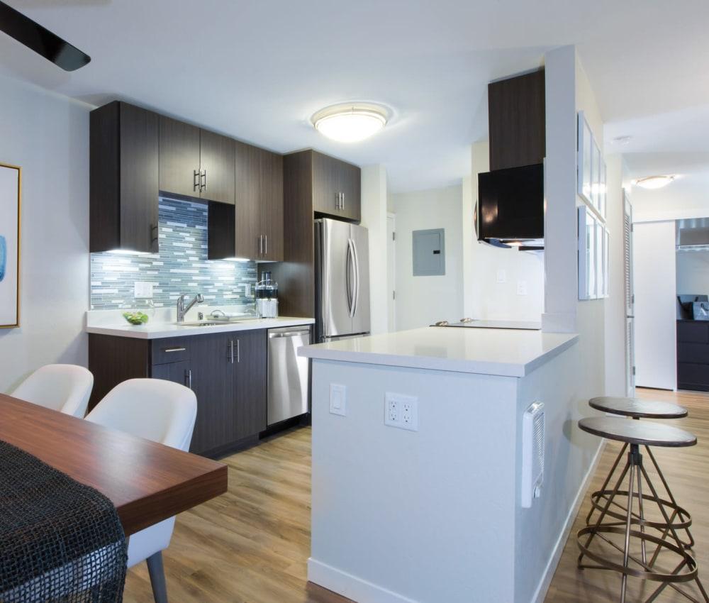 Chef-inspired kitchen with a custom tile backsplash in a model home at Sofi Belmont Glen in Belmont, California