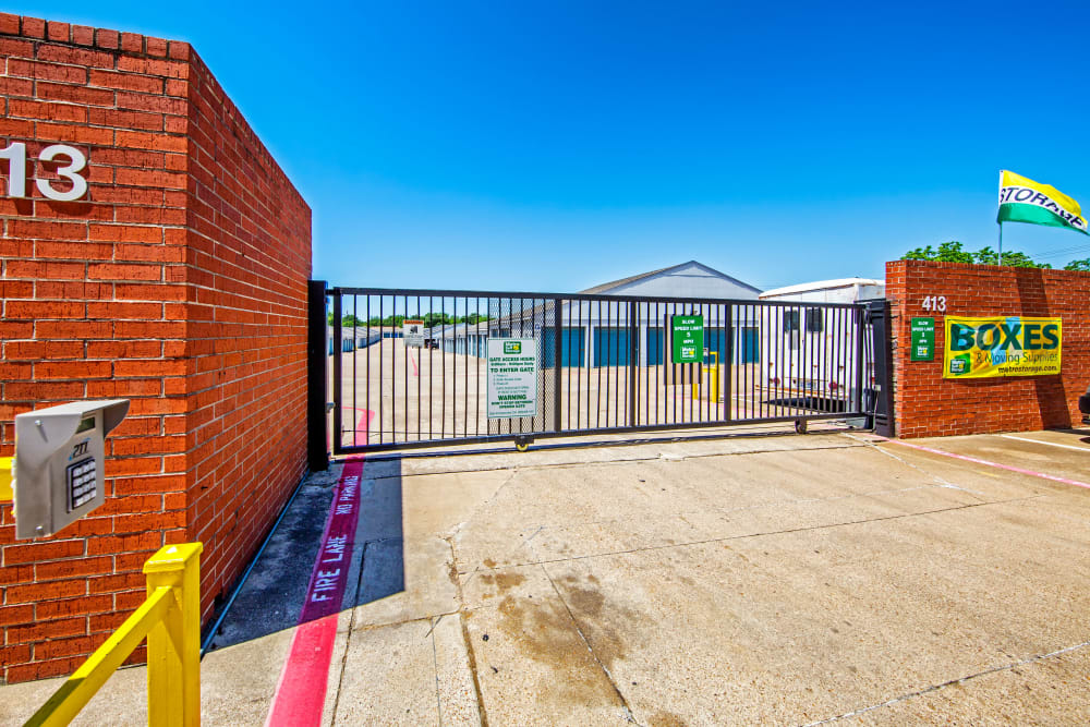 Access gate with security panel at Metro Self Storage in Euless, Texas