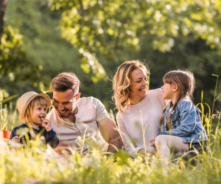 Family enjoying a picnic in lSanta Clara California near Cedartree Apartments