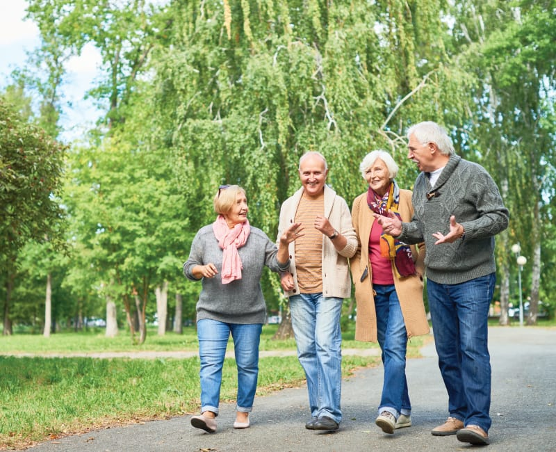 Group of residents walking down a paved path at York Gardens in Edina, Minnesota