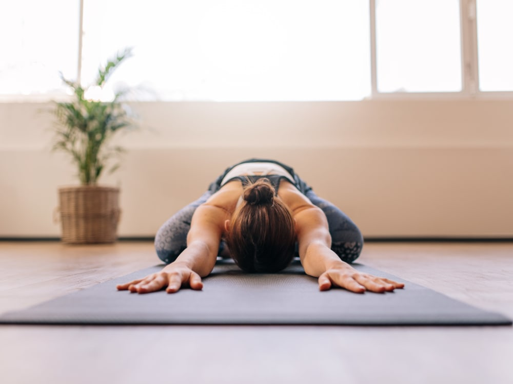 Resident practicing yoga at Terra Apartment Homes in Federal Way, Washington