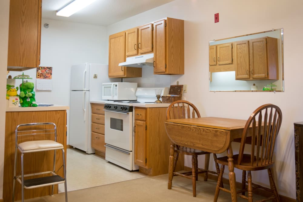 Galley kitchen in resident apartment at Meadow Lakes Senior Living in Rochester, Minnesota.