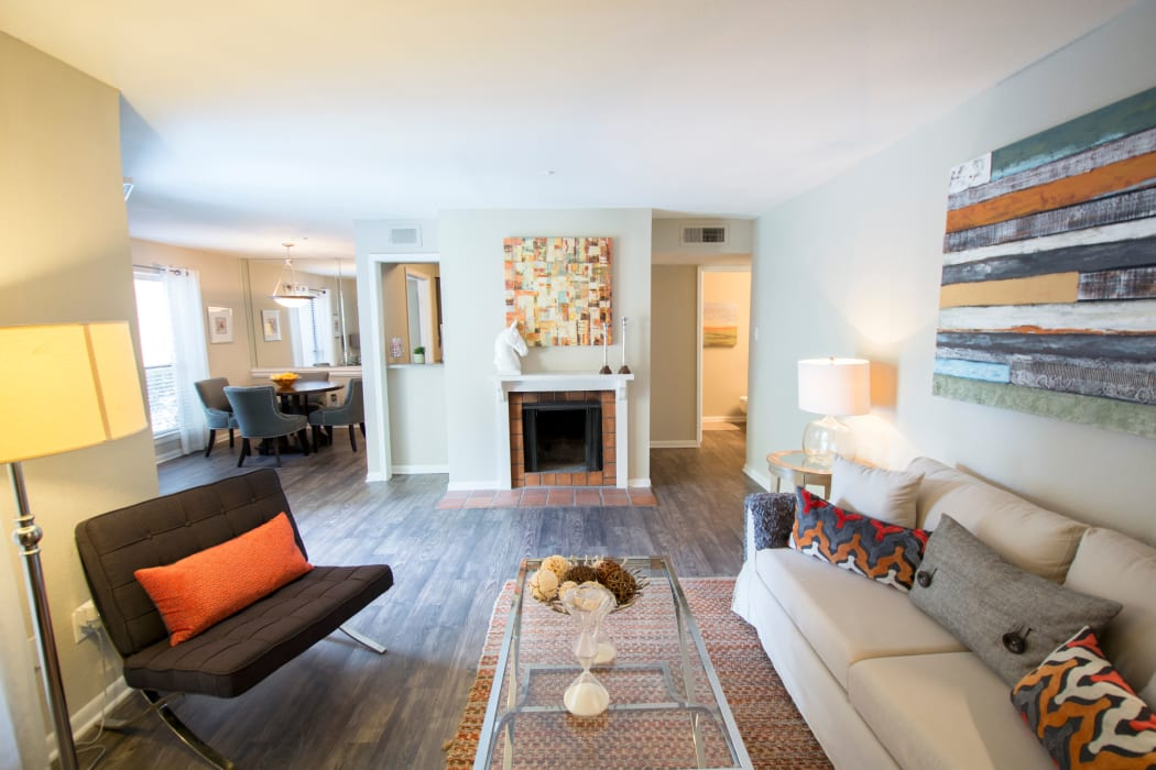 Wood-style flooring in a living room at Stonecrossing of Westchase in Houston, Texas.