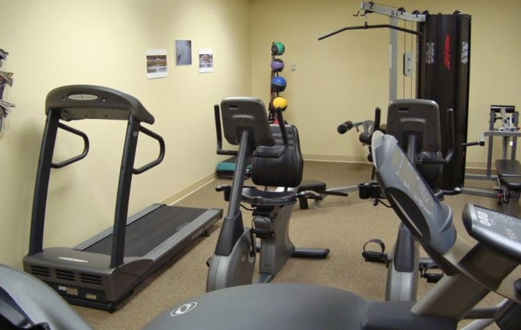 Stay healthy in our fitness center at Racquet Club Apartments