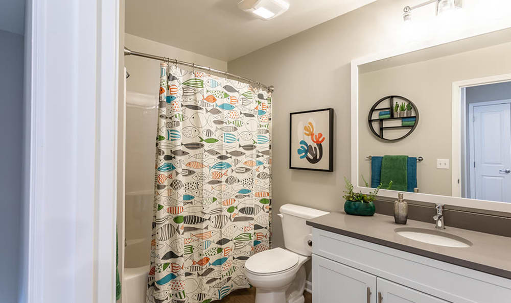 Modern bathroom at Woodland Acres Townhomes in Liverpool, NY