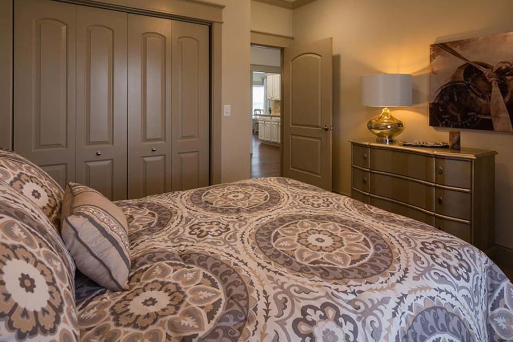 Cozy bedroom with accent lighting at Field Pointe Assisted Living senior living community in Saint Joseph, Missouri