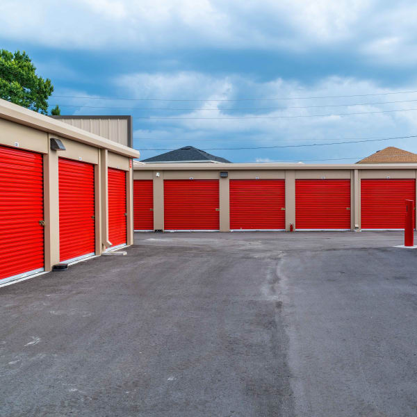 Outdoor storage units with bright doors at StorQuest Express - Self Service Storage in Sonora, California