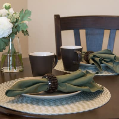 2 placed set at a table inside York Gardens in Edina, Minnesota