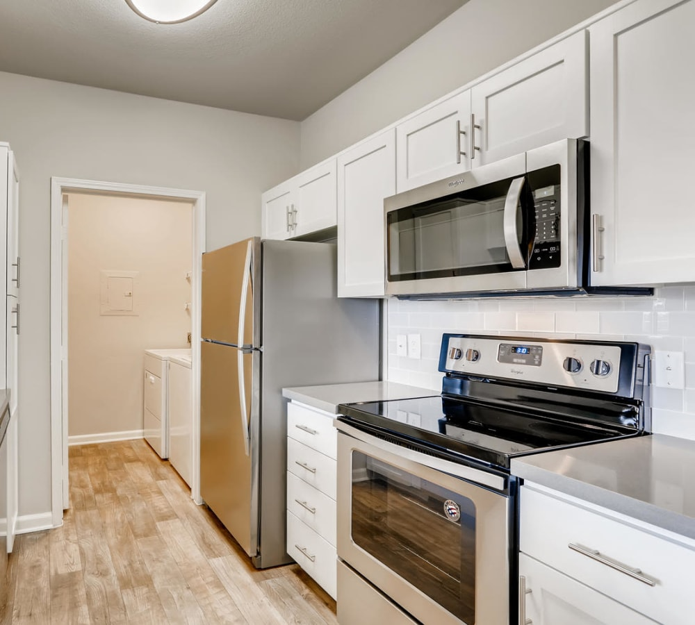 Luxury kitchen with stainless-steel appliances at Alize at Aliso Viejo Apartment Homes in Aliso Viejo, California