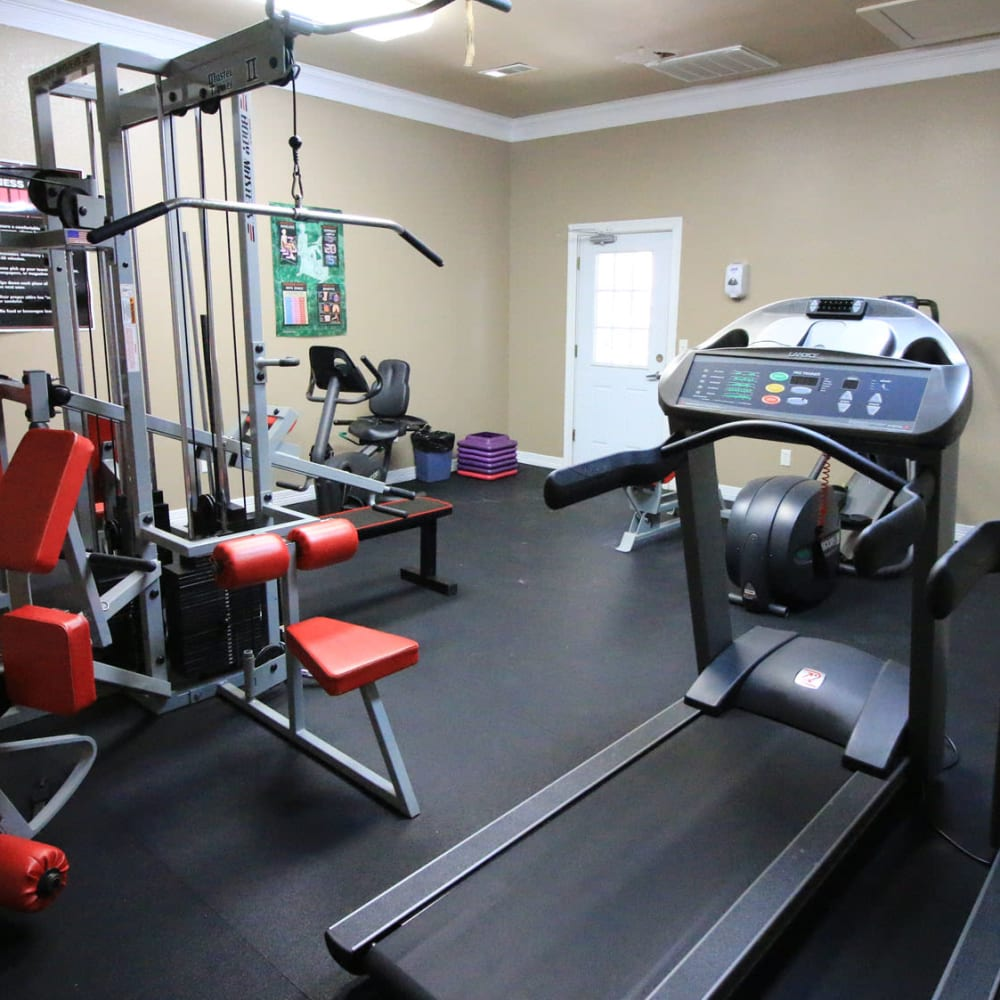 Treadmills and exercise equipment in the fitness center at Oaks Estates of Coppell in Coppell, Texas