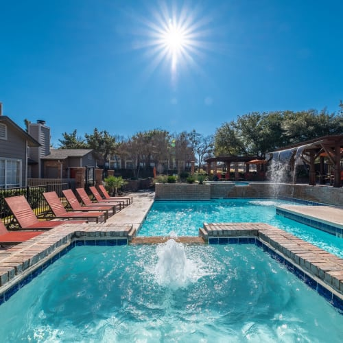 View virtual of the swimming pool area at Village Green of Bear Creek in Euless, Texas