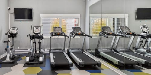 A runner on a treadmill at Elan 41 Apartments's fitness center, in Seattle, Washington