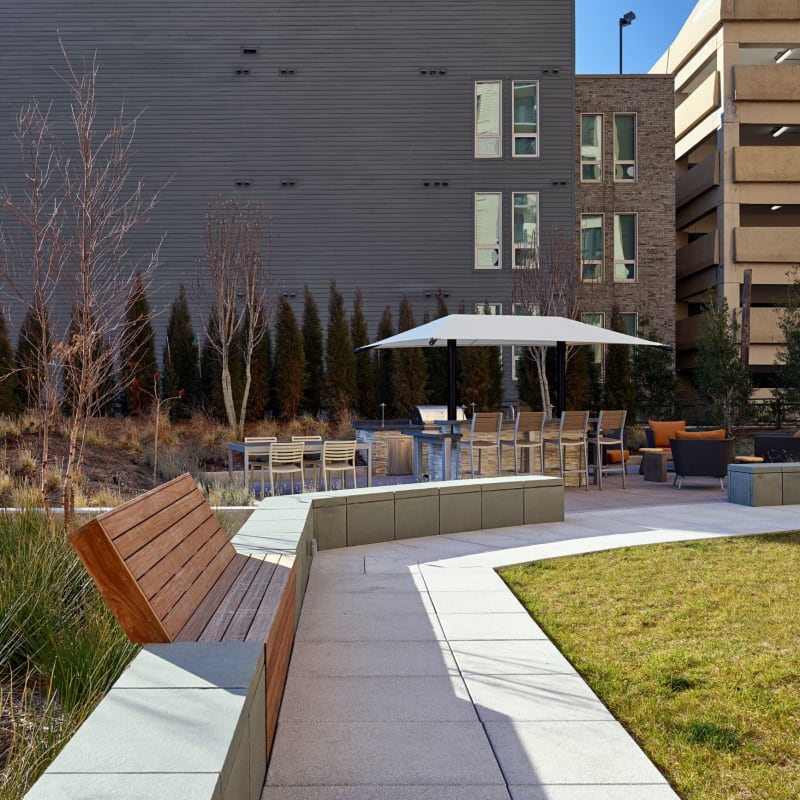Clubhouse patio with a BBQ area at Solaire 8250 Georgia in Silver Spring, Maryland