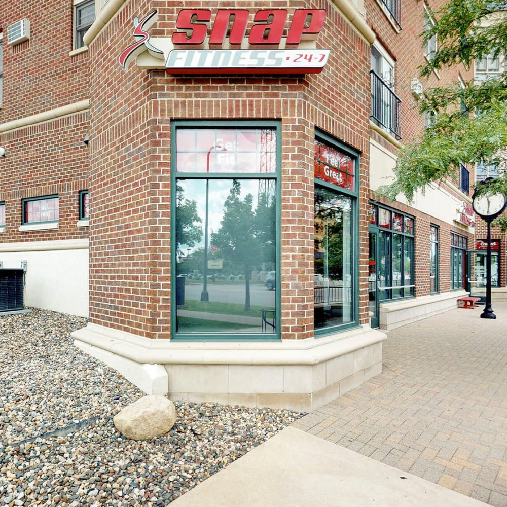 SNAP Fitness and other retail shops at ground level at Oaks Hiawatha Station in Minneapolis, Minnesota