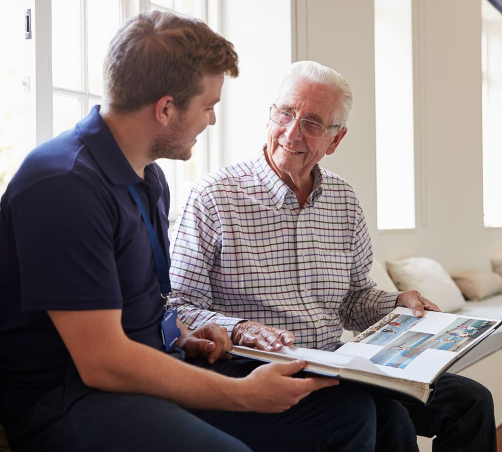 A resident talking to a care team member at Holden of Bellevue in Bellevue, Washington.