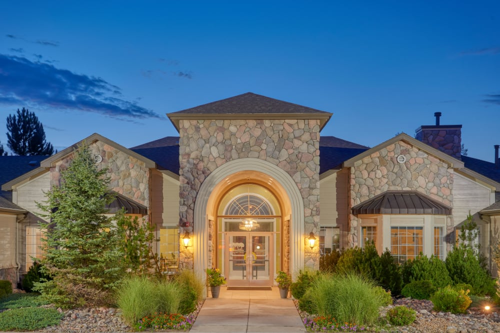 Front of the leasing office at dusk at Legend Oaks Apartments in Aurora, Colorado