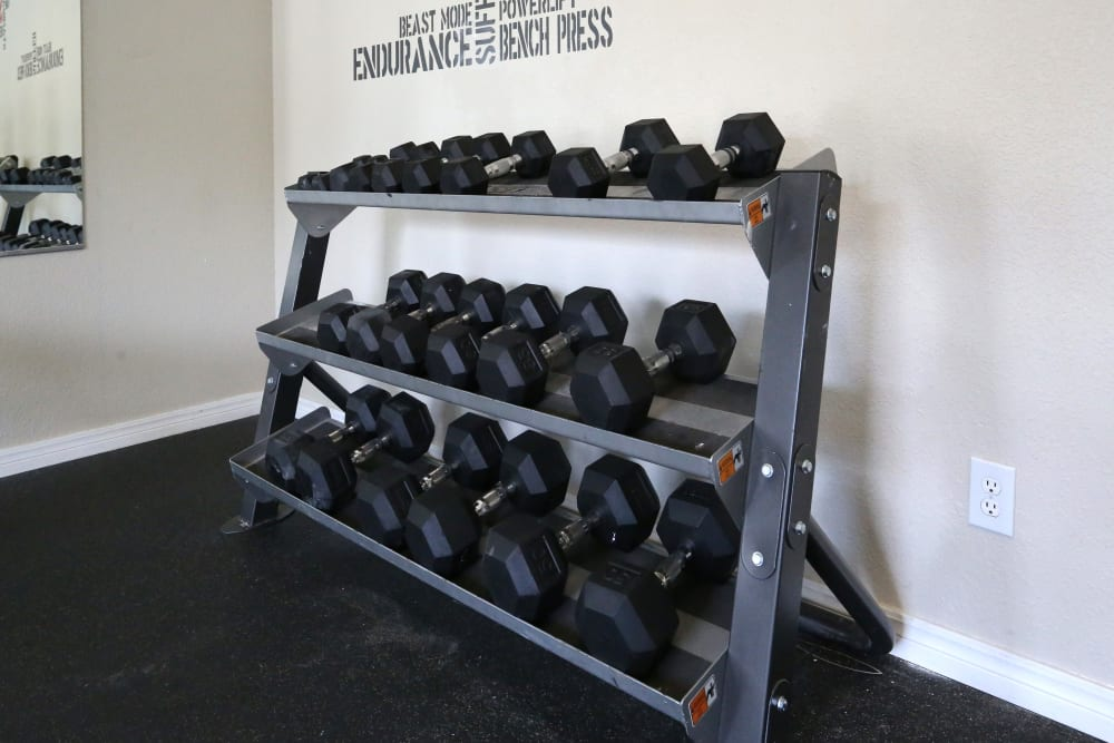 Weights in the gym at Sterling Park in Norman, Oklahoma