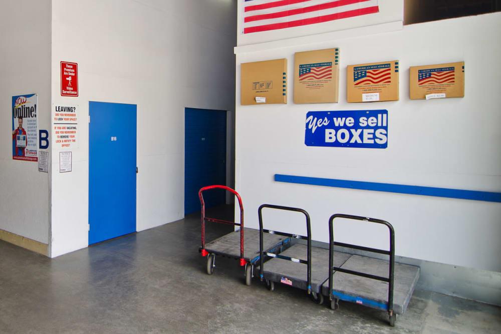 Facility entryway with carts and packing supplies available at A-American Self Storage in Santa Barbara, California