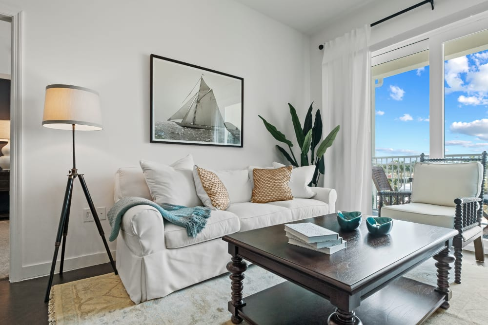 Well decorated model living room and private balcony at Town Lantana in Lantana, Florida