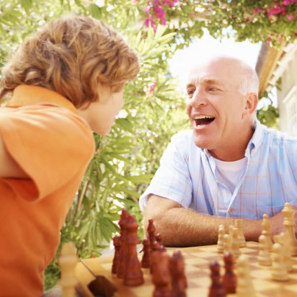 A man and his grandson playing chess at Kenmore Senior Living in Kenmore, Washington