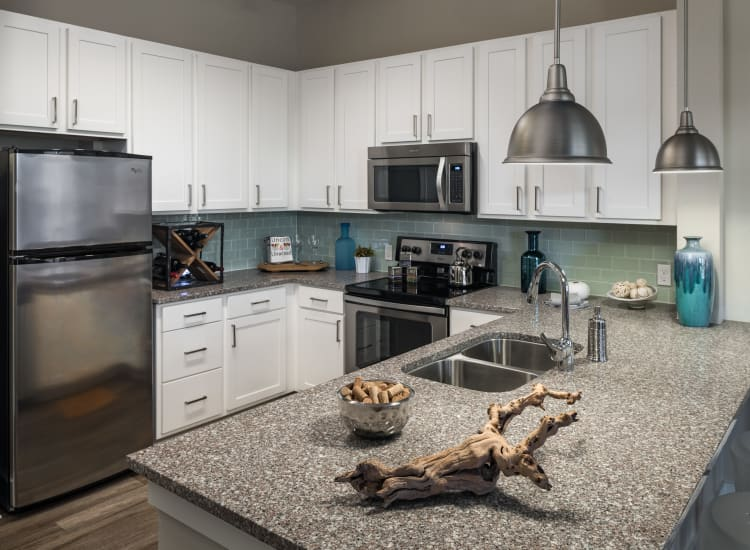 Fully-equipped kitchen at BluWater Apartments in Jacksonville Beach, Florida