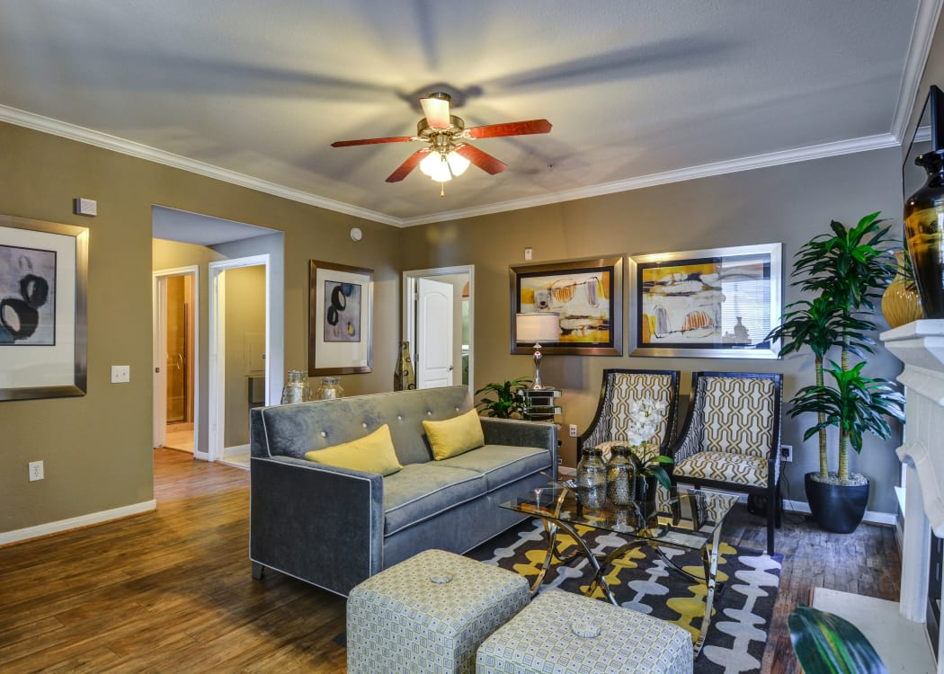Well-decorated living room in open-concept floor plan of model home at San Paloma Apartments in Houston, Texas