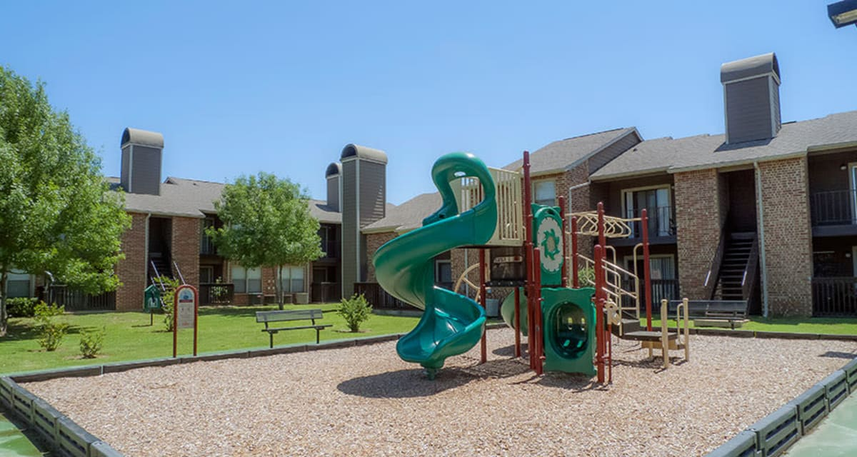 Playground at Greentree Apartments  in  Carrollton, Texas