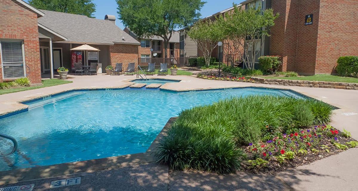 Large pool at Greentree Apartments  in  Carrollton, Texas