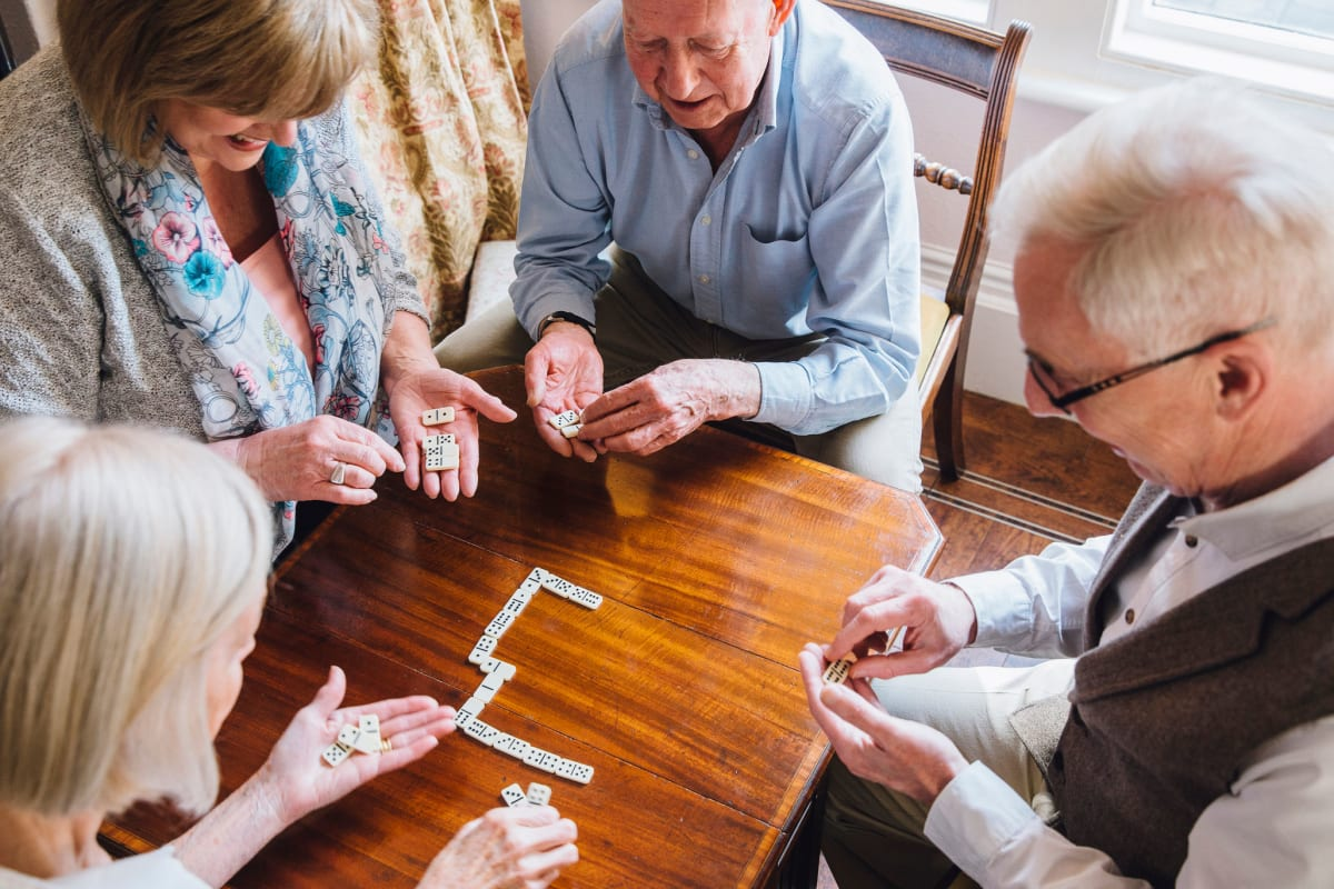 Residents playing a game together at The Oxford Grand Assisted Living & Memory Care in Kansas City, Missouri