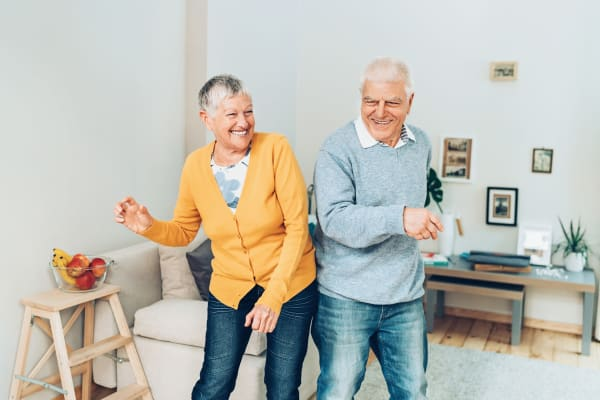Two residents dancing in their living room at Heritage Senior Living in Blue Bell, Pennsylvania.