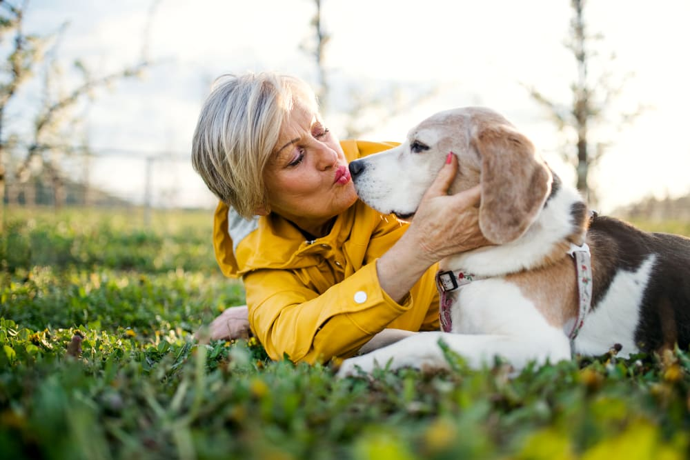 A woman and her dog at Chandler's Square Retirement Community in Anacortes, Washington