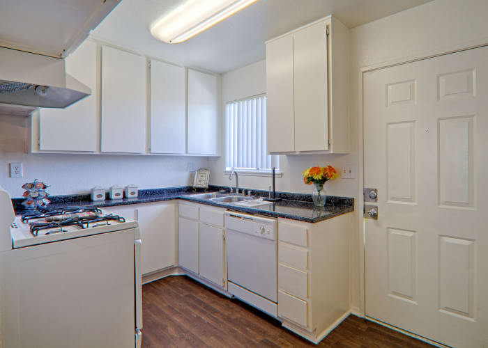 Open kitchen at Woodlands West Apartment Homes in Lancaster, CA