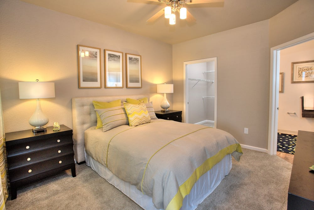 Model bedroom with ceiling fan at Iron Point at Prairie Oaks in Folsom, California