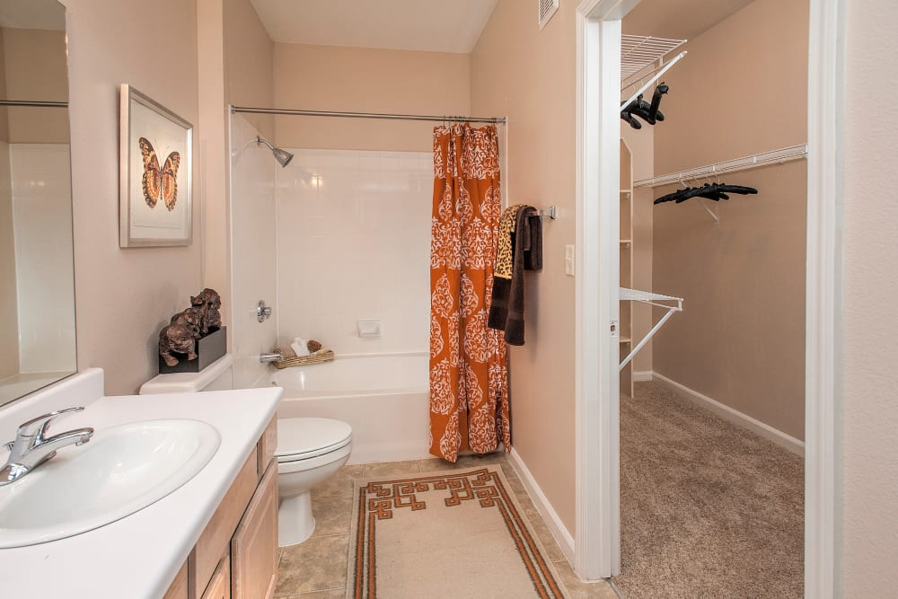 Bathroom with walk-in closet at The Vintage at South Meadows Condominium Rentals in Reno, Nevada