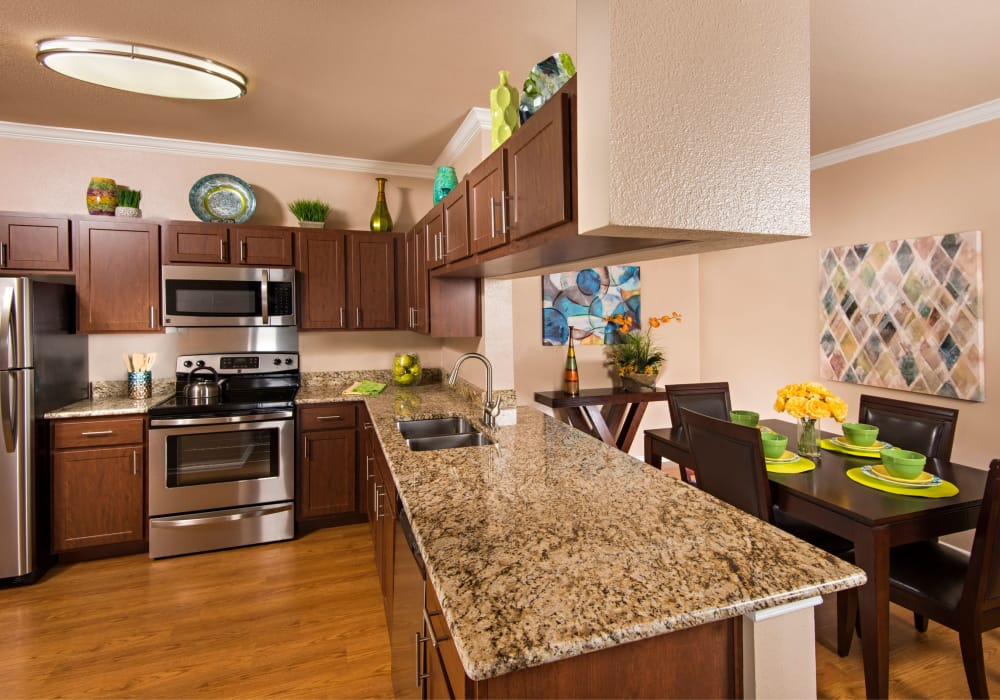 Kitchen with wood-style flooring at Mira Vista at La Cantera in San Antonio