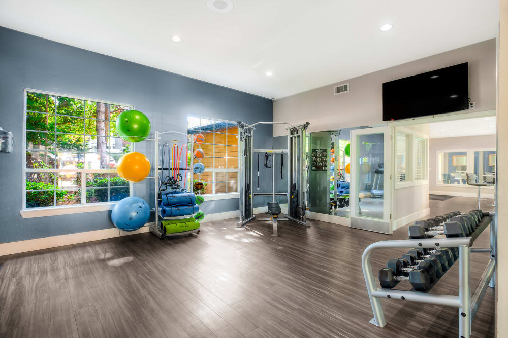 Fitness center with plenty of individual workout stations at Newport Crossing Apartments in Newcastle, Washington