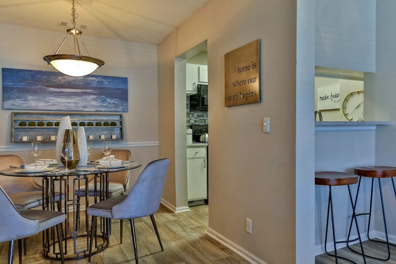 Modern kitchen with breakfast nook and bar seating at Lyric on Bell in Antioch, Tennessee