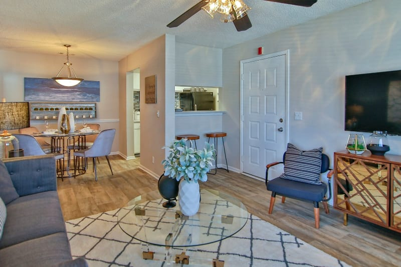 Open concept living room with view of breakfast nook at Lyric on Bell in Antioch, Tennessee