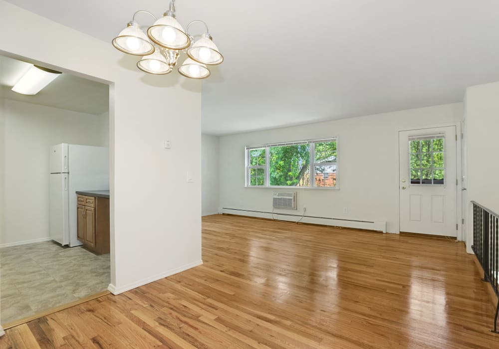 Spacious living room with wood style flooring at Nieuw Amsterdam Village in South Amboy, New Jersey