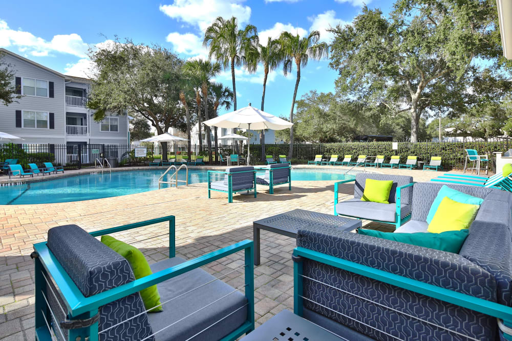 Outdoor lounge area near the pool at Amira at Westly in Tampa, Florida