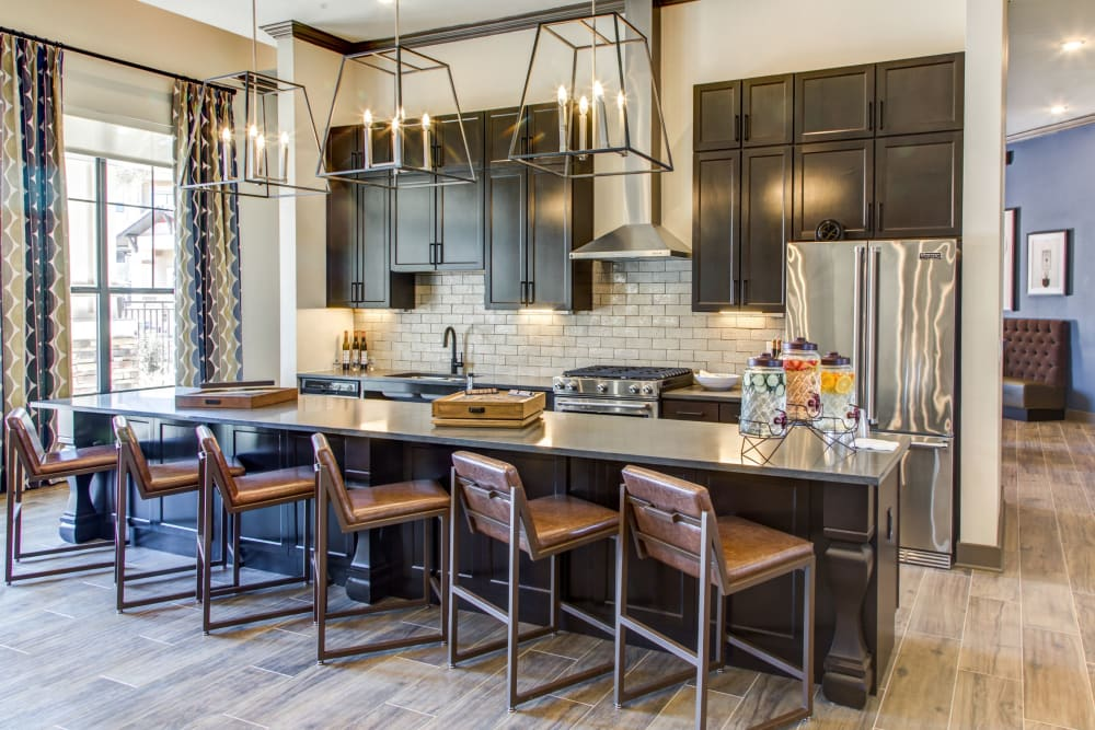 Kitchen area in the resident clubhouse at Waterford Trails in Spring, Texas