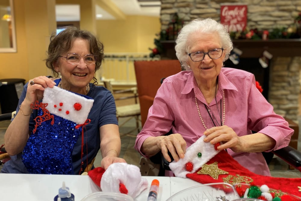Decorating stockings at The Pines, A Merrill Gardens Community in Rocklin, California.