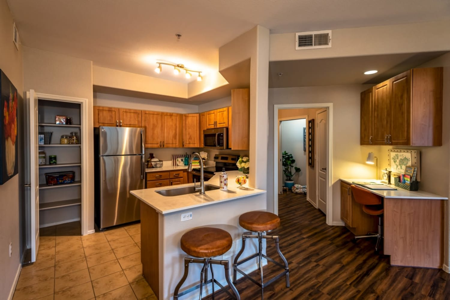Enjoy and open kitchen and living room area at Dobson 2222 in Chandler, Arizona