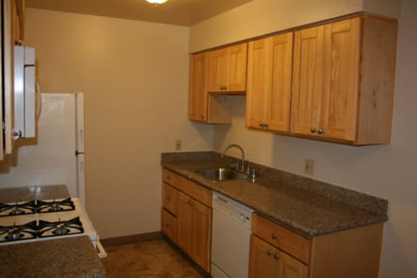 San Tropez Apartments offers a cozy kitchen in Fresno, California