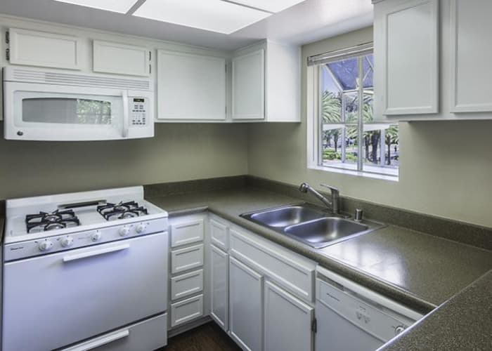 Kitchen with gas stove at Sunset View Apartments