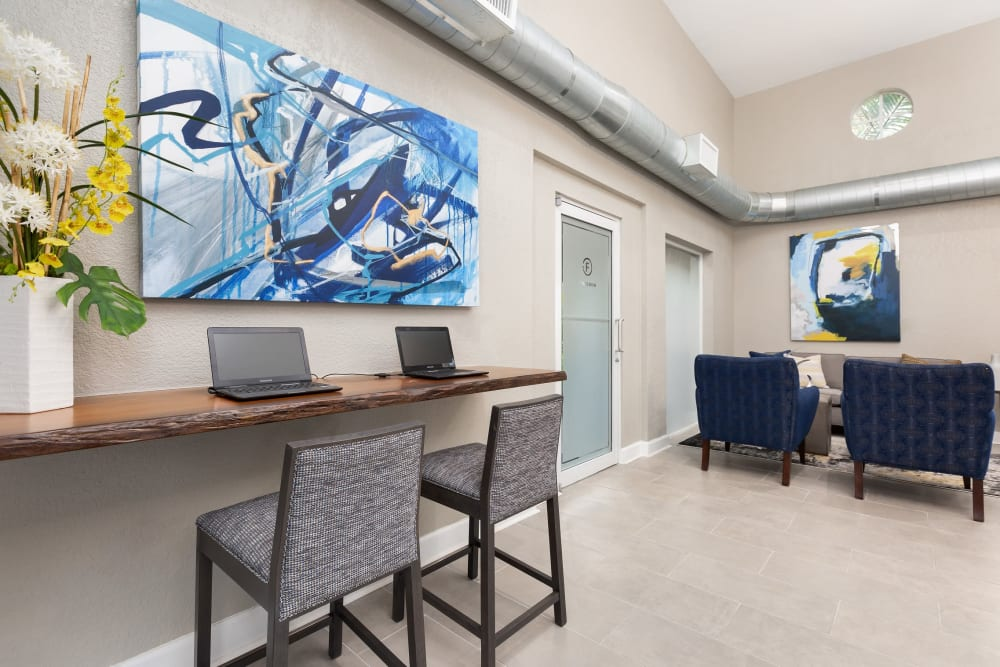 Computer area in clubhouse for residents to work in at Beach Walk at Sheridan in Dania Beach, Florida