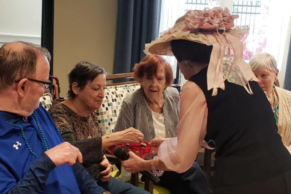 Seniors sharing Valentine chocolate at Beach House Assisted Living & Memory Care at Wiregrass Ranch in Wesley Chapel, Florida