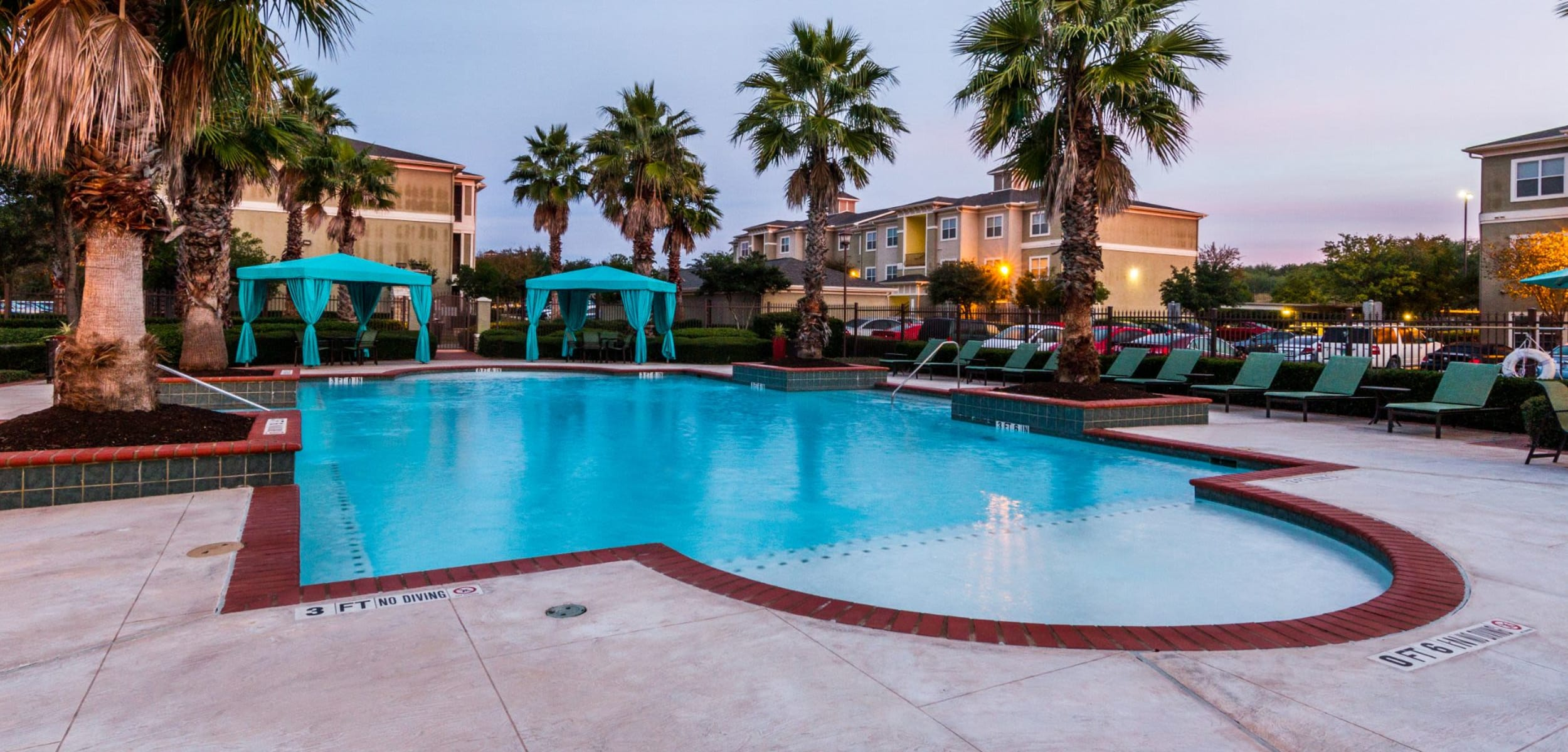 Sparkling pool with palm trees at Marquis at The RIM in San Antonio Texas,